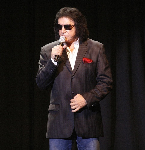 Gene Simmons in shades and a suit, a man who knows how to make music (and money) full time.
